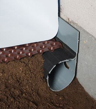 Closeup of a crawl space drainage system installed in Liberty