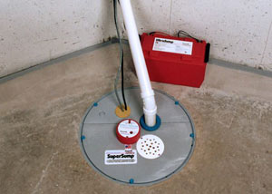 A sump pump system with a battery backup system installed in Hamlet
